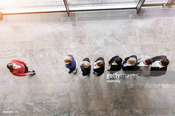 Overhead view of business team in a row in front of boss