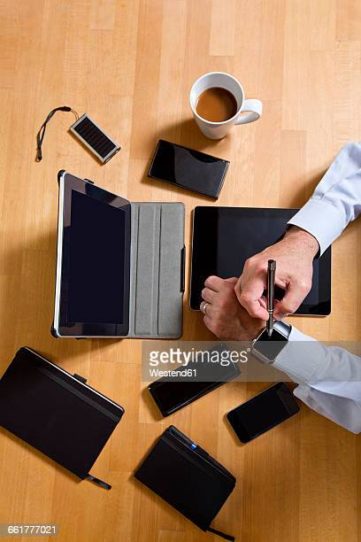 Overhead view of businessman using technology