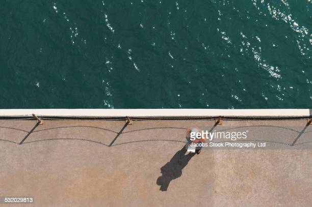 overhead view of caucasian technician reading paperwork near water - marine engineering stock pictures, royalty-free photos & images