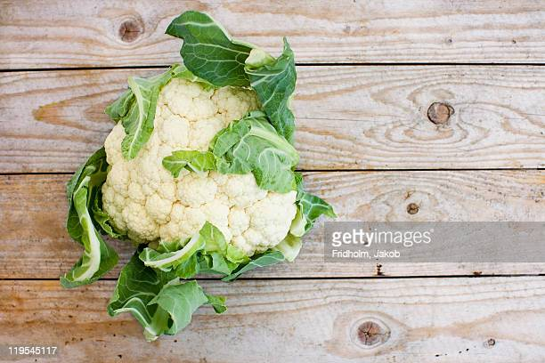 Overhead view of cauliflower on wooden table