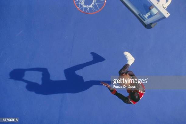Overhead view of Chicago Bulls Michael Jordan as he goes to the basket.