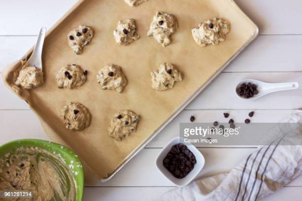 overhead view of chocolate chip cookies being baked in kitchen - baking sheet stock pictures, royalty-free photos & images