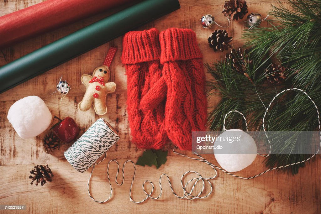 Overhead view of christmas decorations and mittens : ストックフォト