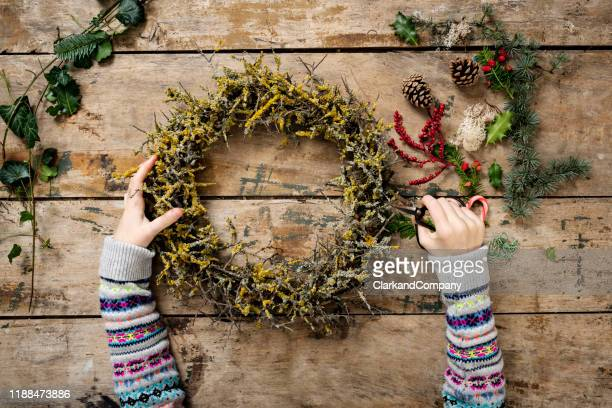 overhead view of christmas garlands being made. - danish food stock pictures, royalty-free photos & images