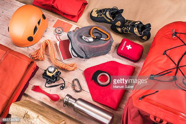Overhead view of climbing equipment packing with first aid kit, climbing helmet, rucksack and climbing ropes