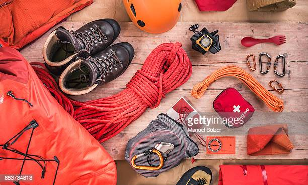 Overhead view of climbing equipment with climbing helmet, first aid kit, climbing boots and climbing ropes