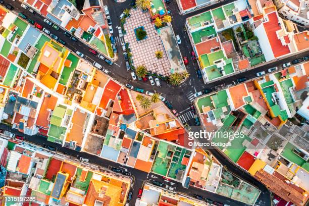 overhead view of colorful cityscape - drone point of view stock pictures, royalty-free photos & images