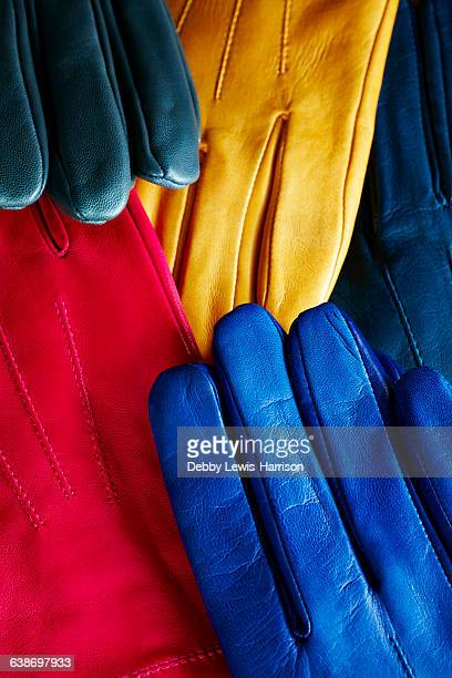 overhead view of colourful leather gloves - leather glove stock pictures, royalty-free photos & images