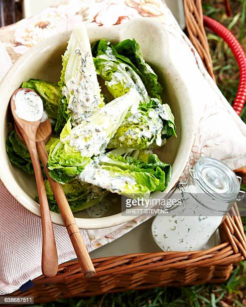 overhead view of cos lettuce smothered with herb salad dressing in bowl - jars with salad stock pictures, royalty-free photos & images