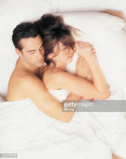 Overhead View of Couple Sleeping in Bed