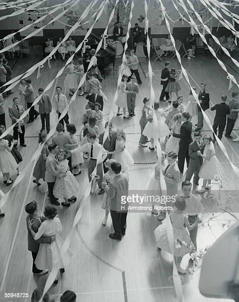 Overhead View Of Couples At Prom Dancing Streamers Decorating Gym