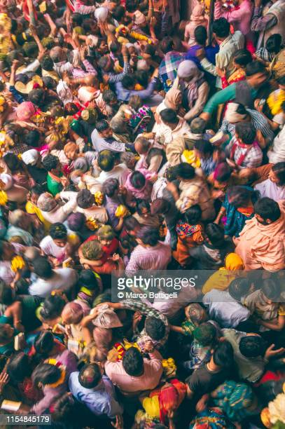 overhead view of crowd in a temple during holi festival, india - hinduism stock pictures, royalty-free photos & images