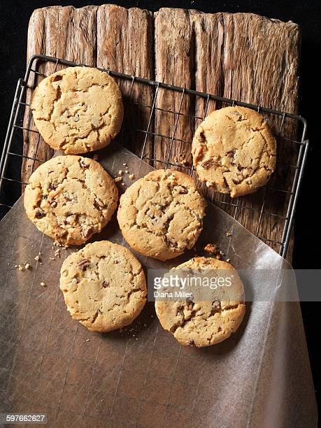 Overhead view of crunchy maple and pecan cookies on wood