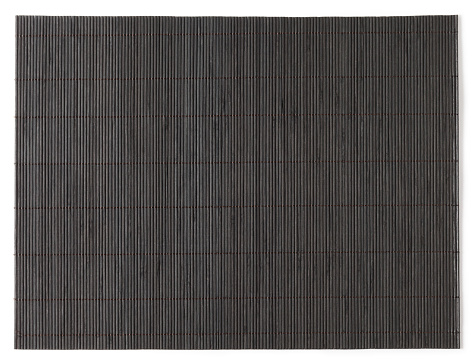 Overhead view of dark stained bamboo mat 183873409