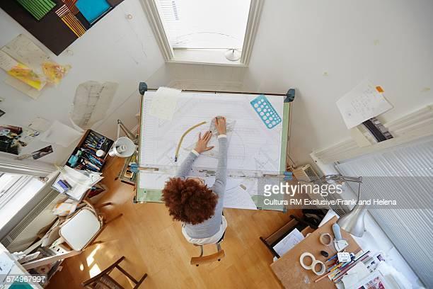 Overhead view of designer working in office