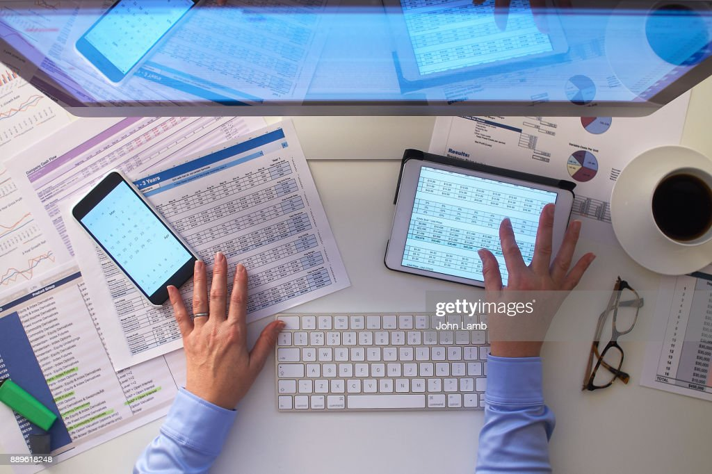 Overhead view of desk space with hands : Stock Photo