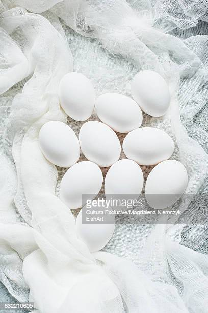 Overhead view of eggs on white muslin