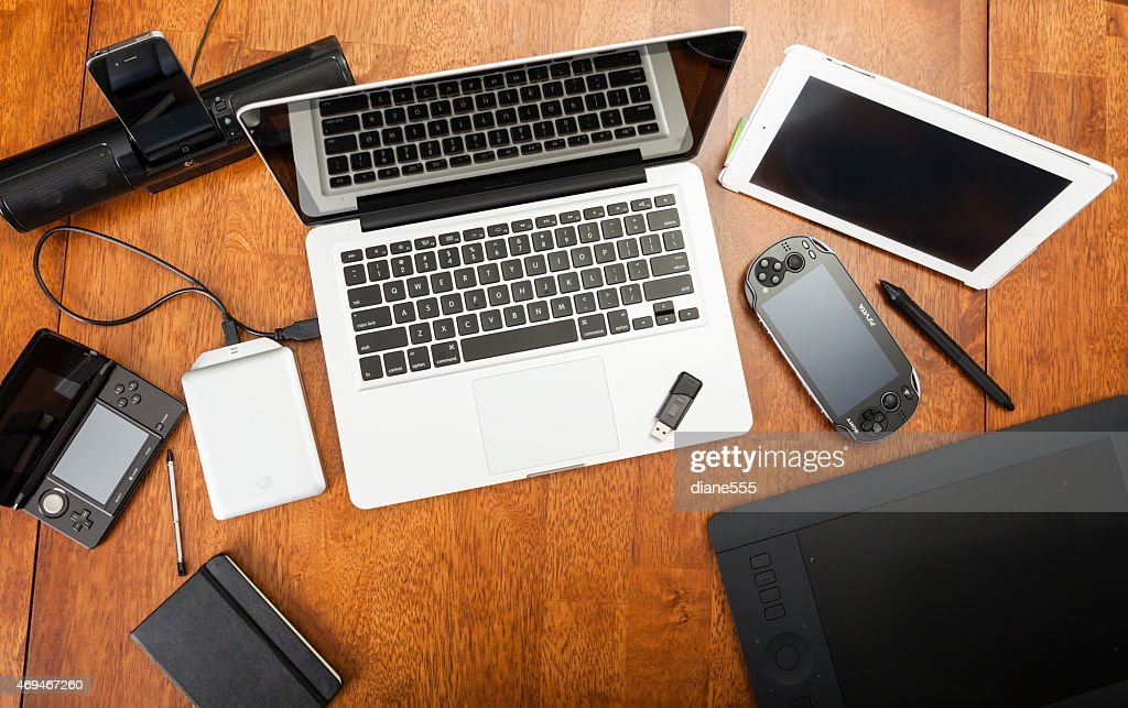 Overhead View Of Electronic Devices On A Desk : Stock Photo