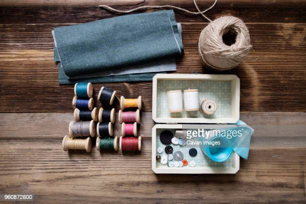 overhead view of fabric with sewing equipment on table - ribbon sewing item stock pictures, royalty-free photos & images