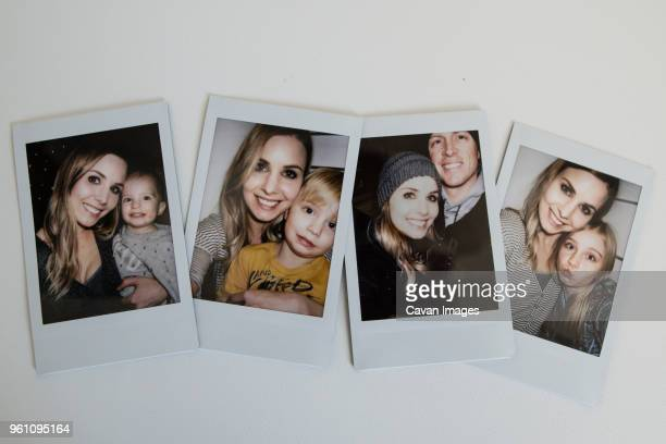 overhead view of family photographs on table - polaroid stock pictures, royalty-free photos & images
