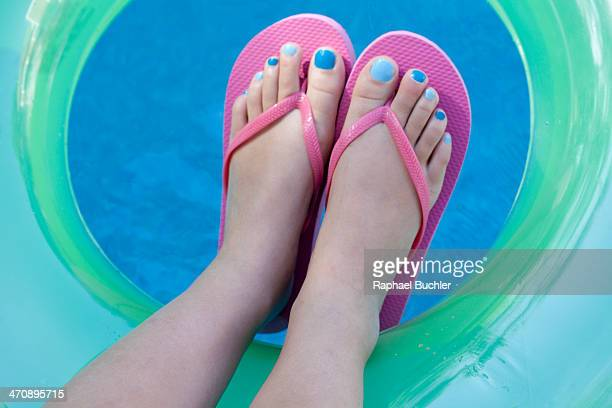 Overhead view of feet with colored nails