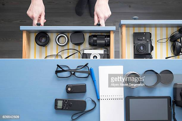 overhead view of female photographers hands opening desk drawer in studio - drawer stock pictures, royalty-free photos & images