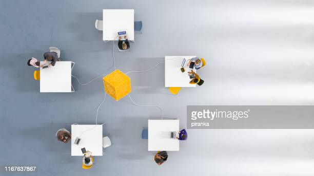 overhead view of five workstations - connection stock pictures, royalty-free photos & images