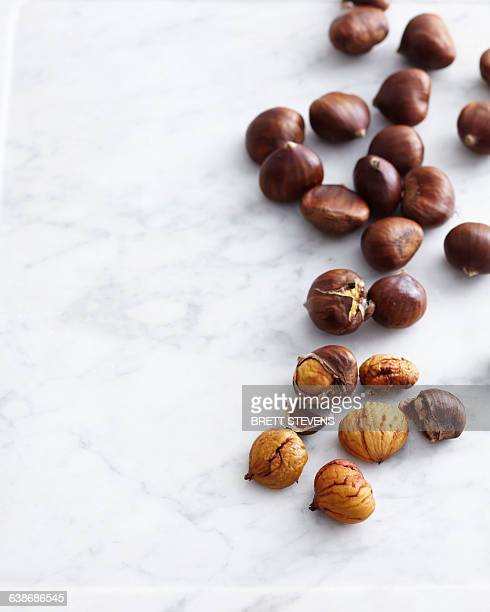 Overhead view of fresh chestnuts on marble table