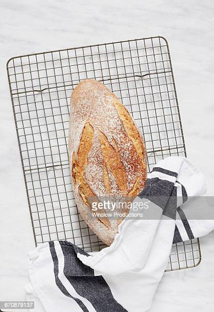 Overhead view of fresh rye bread and dishcloth