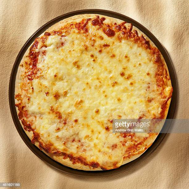 overhead view of freshly baked 3 cheeses pizza - cheese pizza stock photos and pictures