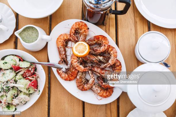 Overhead view of fried shrimps on wooden table