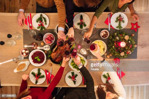 Overhead view of friends at table during christmas dinner