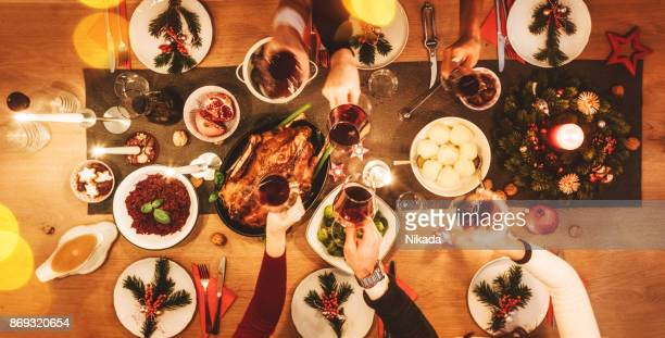 Overhead view of friends at table during christmas party