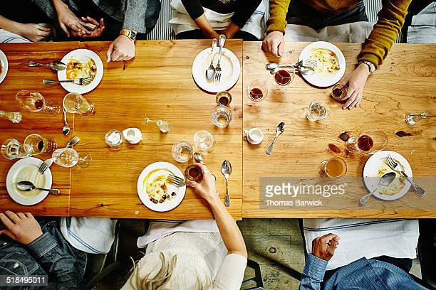 overhead view of friends at table during party - directly above stock pictures, royalty-free photos & images