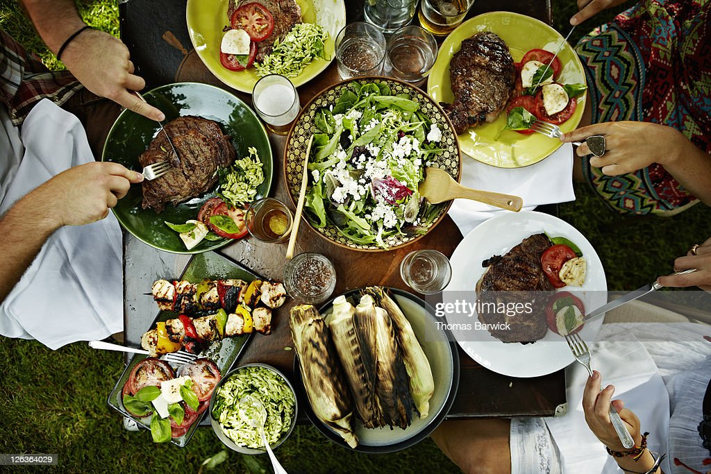 Overhead view of friends dining at table outdoors : Stock Photo