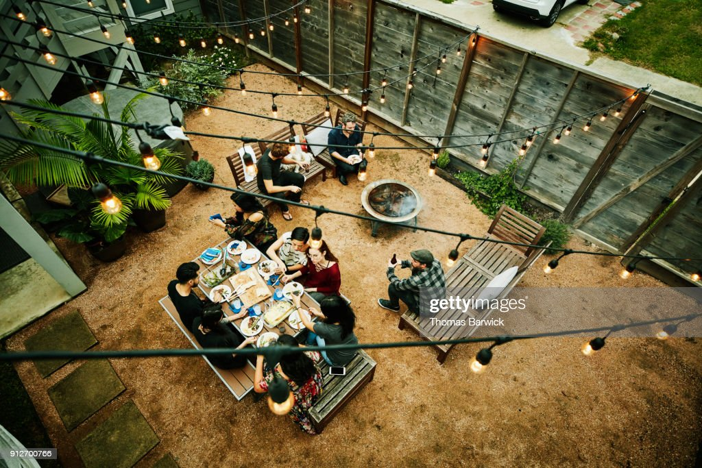 Overhead view of friends dining during backyard barbecue : Stock Photo