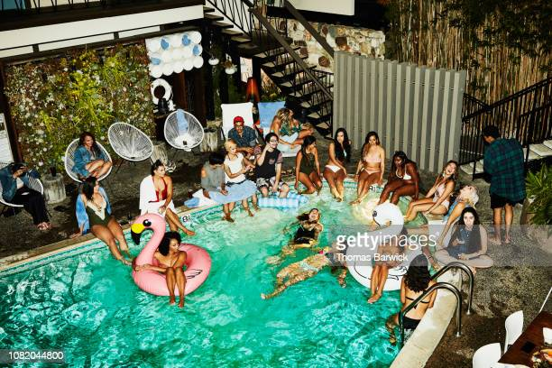 Overhead view of friends having a party at hotel pool