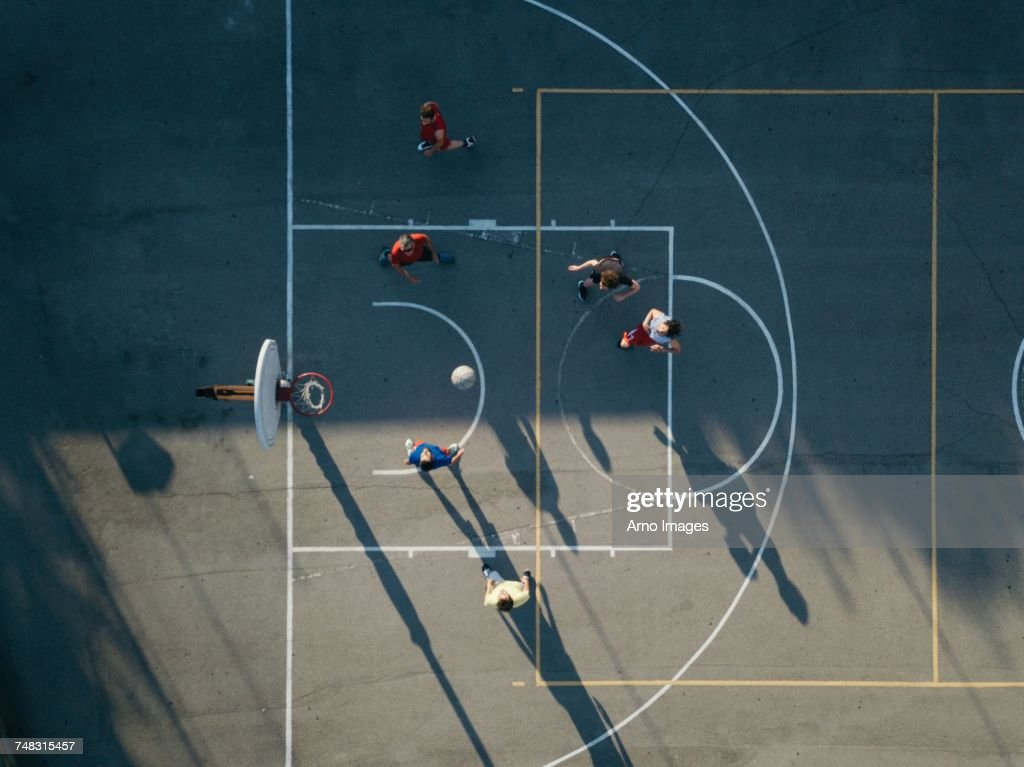 Overhead view of friends on basketball court playing basketball game : Stock Photo