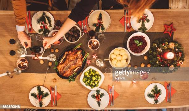 Overhead view of friends prepare table for christmas party