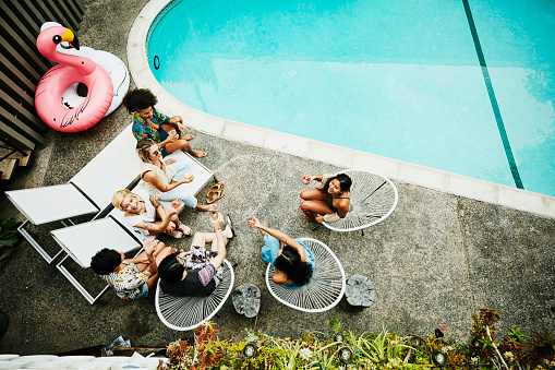 Overhead view of friends sharing drinks while sitting beside hotel pool - gettyimageskorea