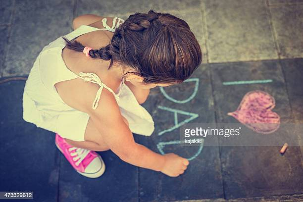 overhead view of girl writing on the sidewalk - fathers day stock pictures, royalty-free photos & images