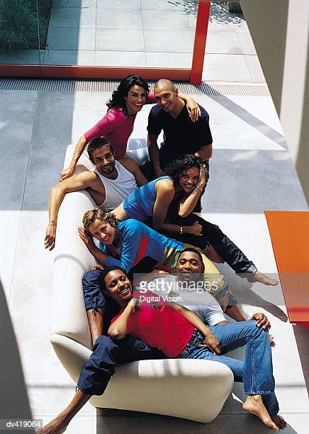 Overhead view of group of friends squeezed on sofa