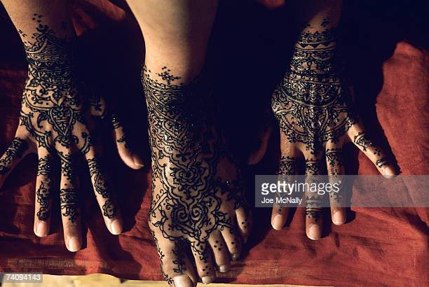 Overhead view of hands and feet with henna painted traditional designs in June of 1998 in Los Angeles California The henna plant is thought to have...