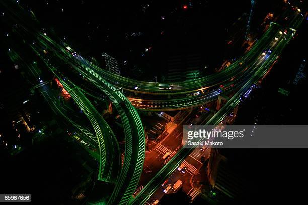 Overhead view of highway at night, Tokyo, Japan