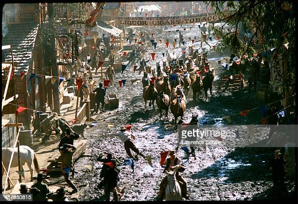 Overhead view of horses as they run down a street in a scene from the film 'Paint Your Wagon' Baker City Oregon 1969