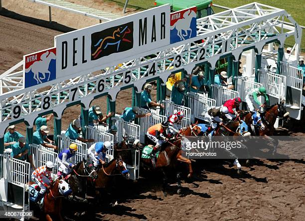 Overhead view of horses breaking from gate on dirt course at Del Mar Race Track July 24 2002
