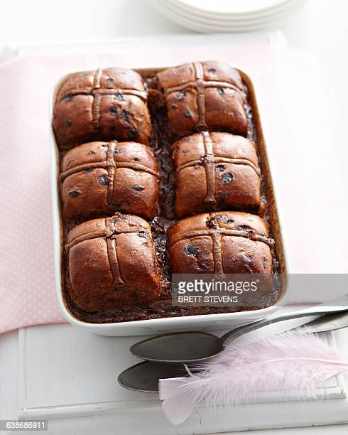 overhead view of hot cross chocolate bread and butter pudding in baking tin - hot cross bun stock pictures, royalty-free photos & images