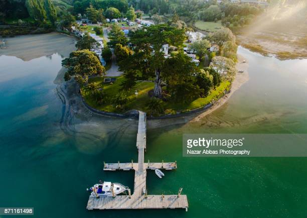 overhead view of jetty with boat parked. - waitemata harbor stock photos and pictures