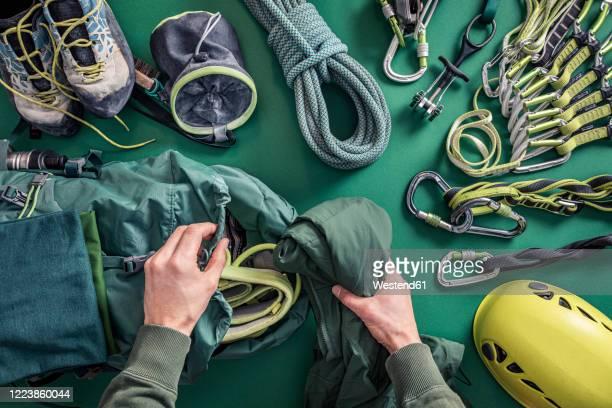 overhead view of man packing climbing utensils - ausrüstung und geräte stock-fotos und bilder