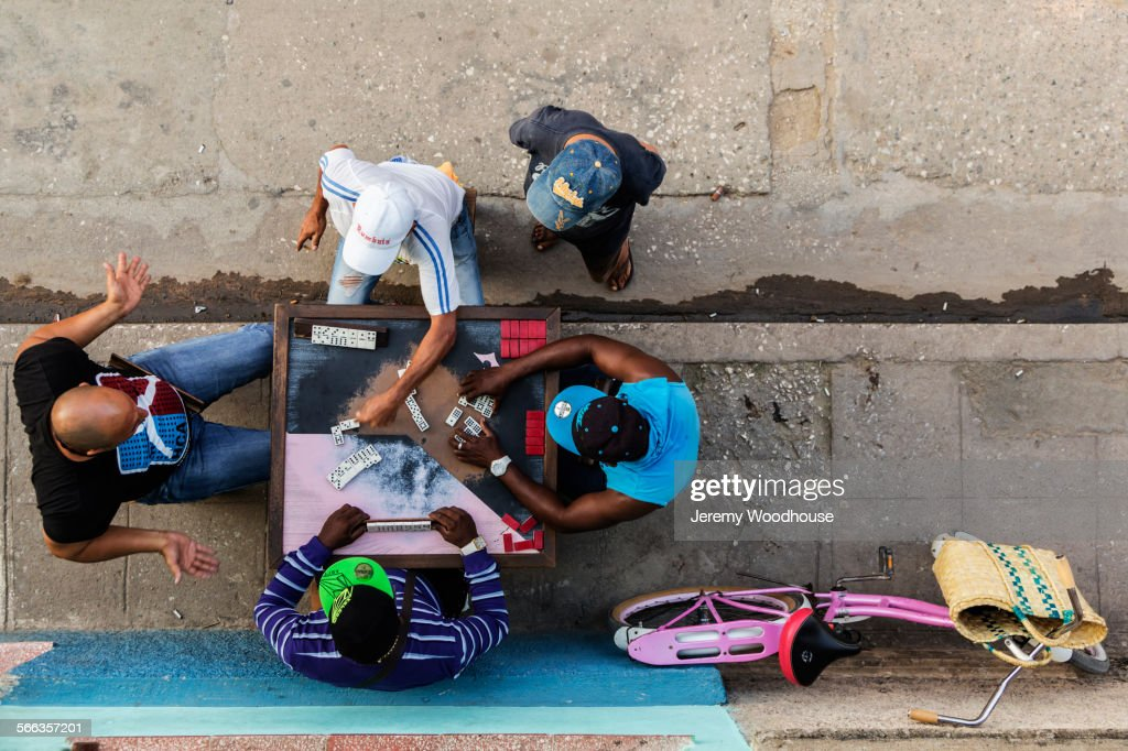 Overhead view of men playing dominoes on Camaguey street, Camaguey, Cuba : Stock Photo